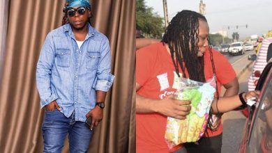 edem sellin feat 390x220 - Photos & Video: Rapper Edem Spotted Selling In Traffic